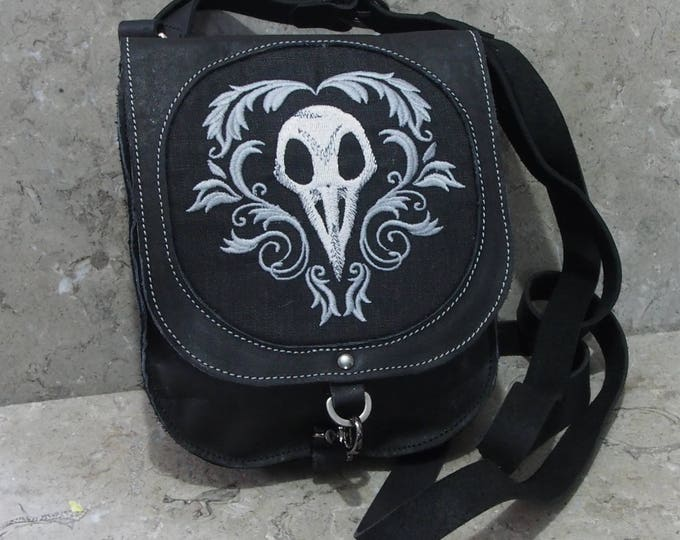 Leather satchel with bird skull embroidery