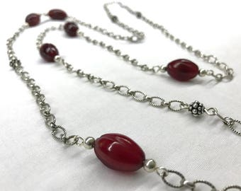 Sterling silver and carved carnelian long necklace