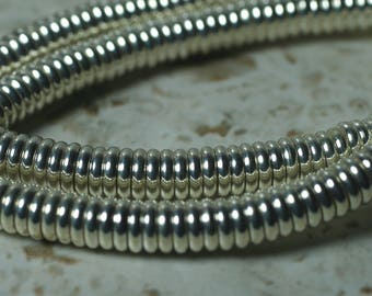 Silver tone rondelle beads aprox 6mm in diameter 2mm thick hole size aprox 1mm, 12 pcs (item ID FA2467MB)
