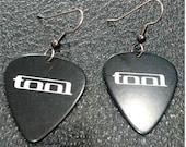 Guitar pick earrings made with TOOL guitar picks