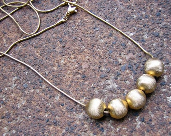 Eco-Friendly Slide Bead Statement  Necklace - Perpetual Motion - Recycled Slinky Vintage Snake Chain and Textured Goldtone Metal Beads