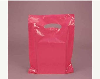 STOREWIDE SALE CLEARANCE sale 50 Pack Hot Pink Opaque Cut Out Handle 12 X 15 Inch Size Retail Merchandise Plastic Bags
