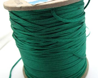 Large spool of woven green satin cord - tassel making, necklace etc
