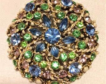 Vintage Weiss Brooch with Pale Blue, Green, and Lavender Rhinestones Set in White Enamel with Gold Antiquing Two Inches in Diameter. (D17)