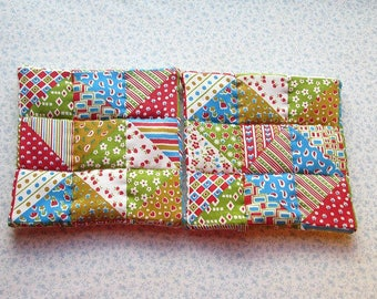 SALE  was 9.50 NOW 6 blue green and red  vintage fabric hand quilted set of 2 potholders hot pads