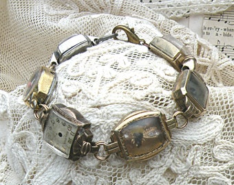 assemblage bracelet recycled vintage watch cases mini diorama keepsake hiding memento rustic quirky