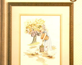 An Offering Plain Girl Picking Apples Tree White Ducks Being Curious Counted Cross Stitch Embroidery Craft Pattern Leaflet Leisure Arts 583