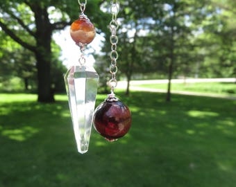 Clear Quartz pendulum with a yellow Opal and a red Tigers eye bead on the end