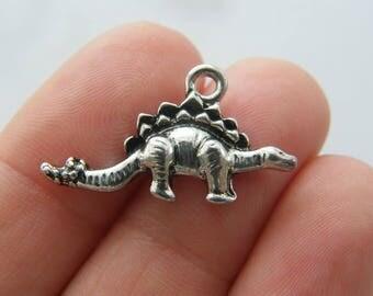 4 Dinosaur Stegosaurus charms antique silver tone A651