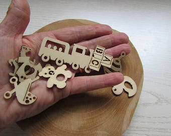 Wooden baby themed embellishments