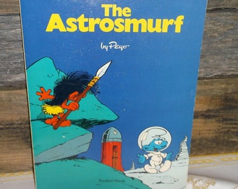 Vintage 1978 The AstroSmurf by Peyo A SMURF Adventure Paperback book with Comic Strip format written by Delporte and Peyo the Smurfs