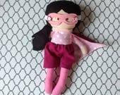 Girl Superhero Doll with peach skin, black hair, brown eyes