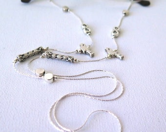 Eyeglass and Sunglass Holder, Chain Necklace steel cha  Silver  beads and silver tone Elements, attached to a steel chain.