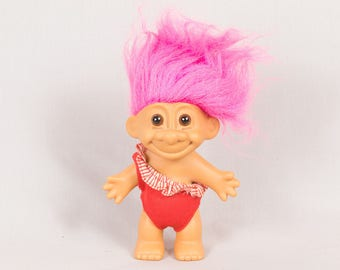 Russ Troll doll Girl troll Pink hair and Removeable red bathing suit Bright pink hair Round ears Vinyl body Brown eyes 4 ins tall Pristine