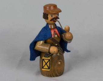 Erzgebirge wood carved smoker coachman with horn, lantern wearing blue cape. Made in East Germany Smoker incense burner