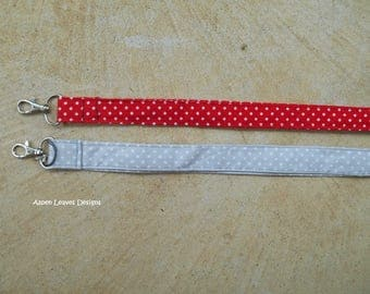 Polka dot Fabric lanyard. Gray with white dots. Plus charms.