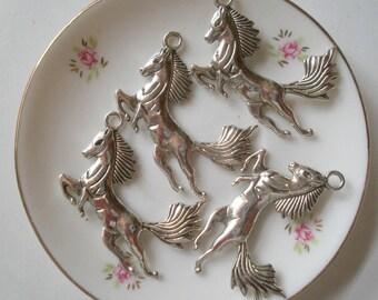 4 pendant style charms Tibetan horse