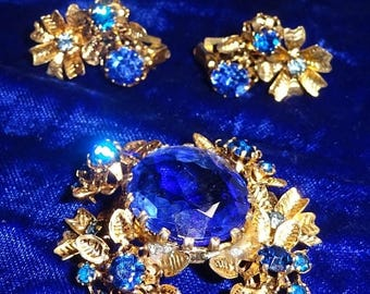 25% Off Antique Austria signed floral brooch and earrings Demi blue rhinestone flowers ornate filigree Signed Made in Austria Blue Open Back