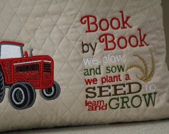 Reading pillow featuring red tractors(Farmall)