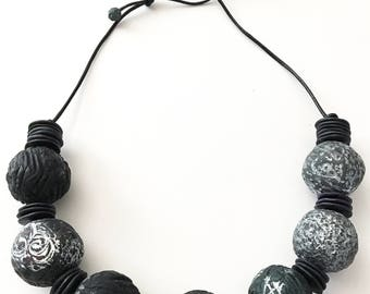 Polymer clay bead necklace strung on Greek leather cord.
