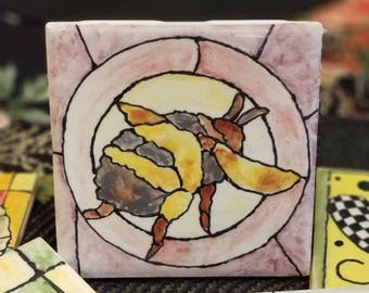 4 1/4 by 4 1/4 inch hand painted kiln fired Bee Tile