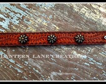 Leather cuff w/copper flowers