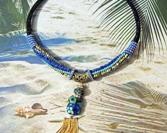 Crew neck beads braided matubo and silk, spun creator owl pearl hand