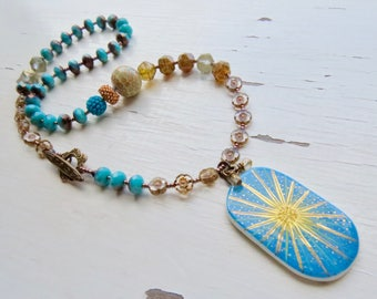 Keep your face to the sun - handmade artisan bead necklace in blue and bronze gold with handmade ceramics and lampwork glass - Songbead, UK