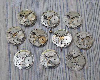 0.9 inch Set of 10 vintage wrist watch movements.