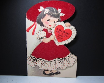 Adorable 1950's Rust Craft die cut valentine for a very sweet girl cute girl in red flocked bonnet and dress holds a valentine