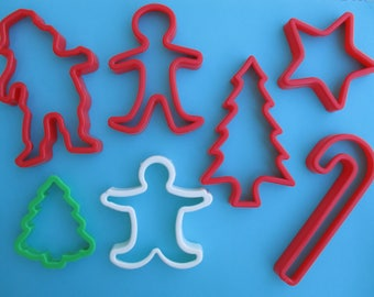 Vintage Christmas Cookie Cutters Set of 7 Plastic Santa, Tree, Candy Cane, Gingerbread man, Star