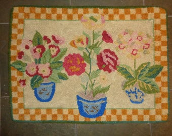 Vintage Hand Hooked Floral Still Life Accent Rug in Good Condition in a bright, beautiful, primary color palette which can be washed by hand