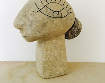 Lady styling her Chignon Clay Sculpture