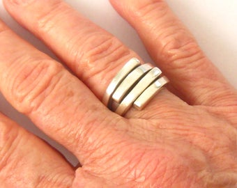 Sterling Modernist Ring. Split Side Shanks have 4 Squared Ends Which Line up Perpendicullarly at Top. Design Makes Minor Sizing Easy. Sz 6-8
