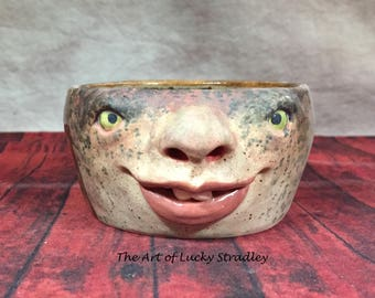 CERAMIC BOWL -small-Wheel thrown, hand altered & sculpted. Just a friendly face to hold small items, candles, Q Tip or favorite candy. CBS2
