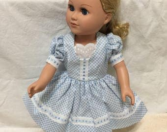 18 in doll with doll dress that fita American Girl and Mommy &Me