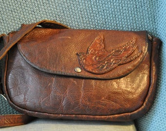 Handmade leather purse with hand tooled bird on front