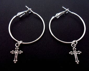 """A pair of silver plated 30mm 1"""" hoop and cross earrings."""