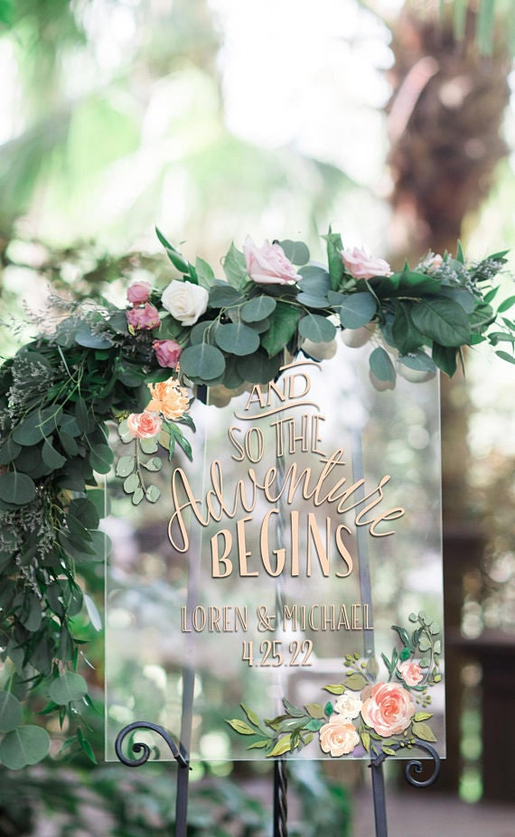 acrylic wedding sign with gold calligraphy and floral garland