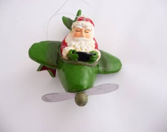 Vintage Christmas Tree Ornament Flying Santa In A Green  Airplane