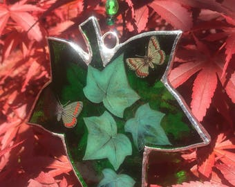Emerald green stained glass ivy leaf.