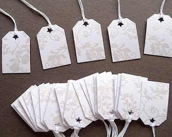 25 sturdy, embossed white tags