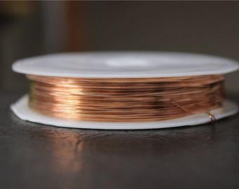 a spool of 0.4 mm rose gold plated copper wire 13 M