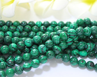 a yarn of 50 8mm malachite stone beads