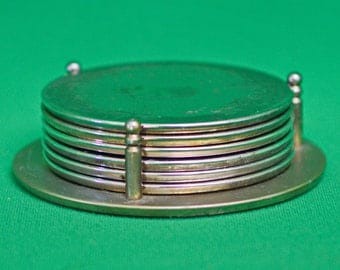 Vintage Metal And Rubber Set Of 6 Coasters With Stand