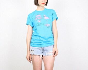 Vintage anni 1980 Tshirt 80s Tshirt Teal blu caldo rosa fenicottero dolce Adelines Miami FL corsa schermo stelle T camicia migliori Tee molle usurate S M medio