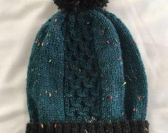 Knitted cable hat with pompom
