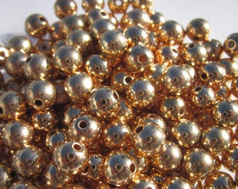 40 round beads 6 mm gold acrylic (4122)