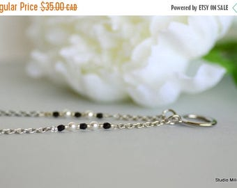 ON SALE Eyeglasses Necklace with White Pearls, Swarovski Elements, Eye glasses Holder, Loop for Glasses, Spectacle Chain, Minimalist, Stainl