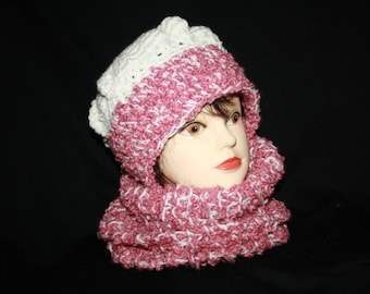 closed collar and pink and white marl beret set off ringlets